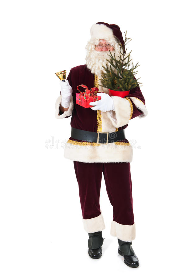 Santa Claus with Christmas tree. And copper bell isolated over white background stock photo
