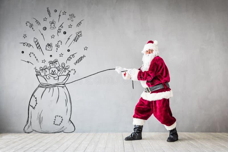 Santa Claus Christmas Xmas Holiday Concept. Santa Claus holding bag. Christmas Xmas holiday concept stock photos