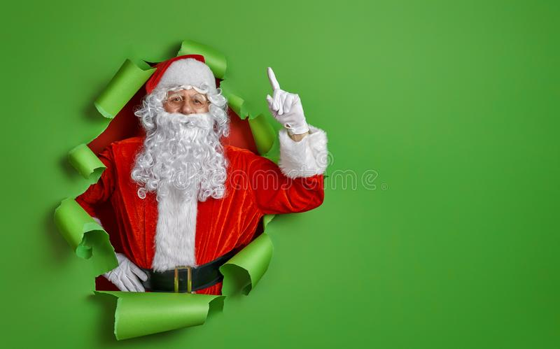 Santa Claus on color background. Merry Christmas and Happy Holidays! Santa Claus on bright color background stock photos