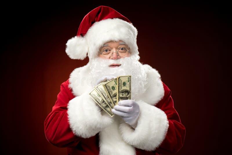 Santa Claus com dólares fotografia de stock