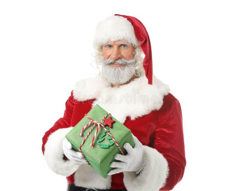 Santa Claus com o presente no fundo branco fotos de stock royalty free