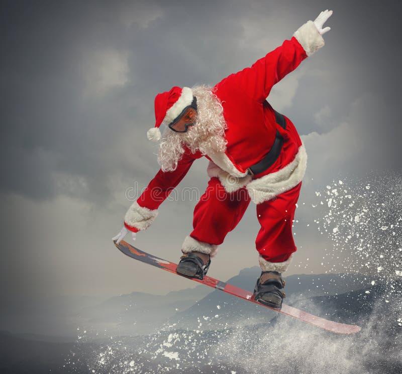 Santa Claus com snowboard fotos de stock