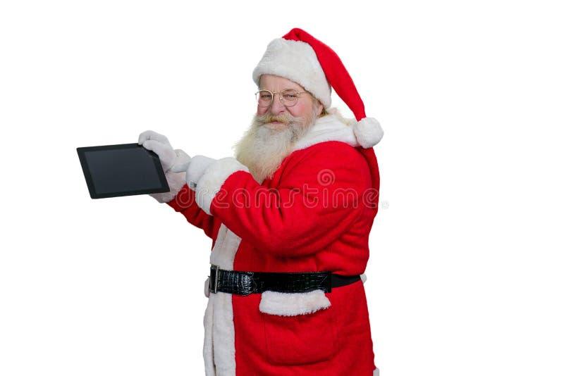 Santa Claus com tabuleta do computador imagem de stock royalty free