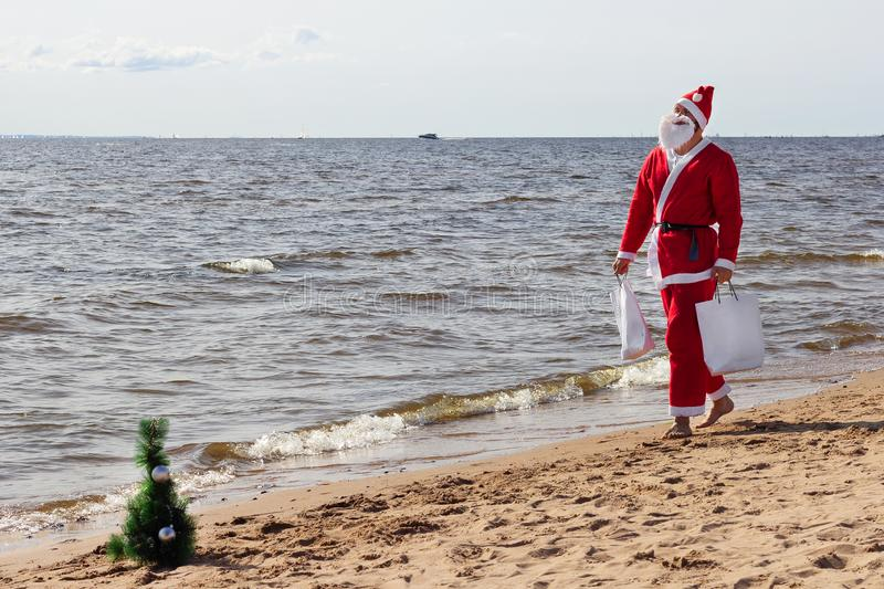 Santa claus comes with presents gifts   coming christmas holiday happy year royalty free stock images