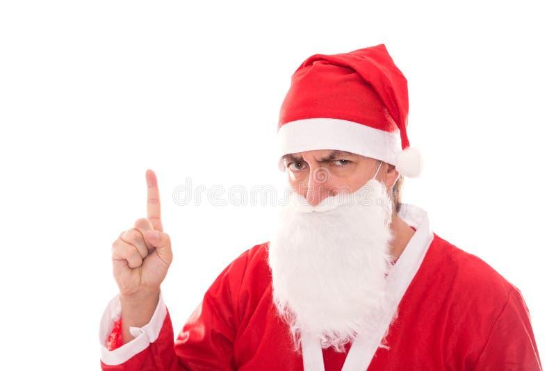 Santa Claus con il fronte scontroso che mostra a Copyspace, isolato su w fotografia stock