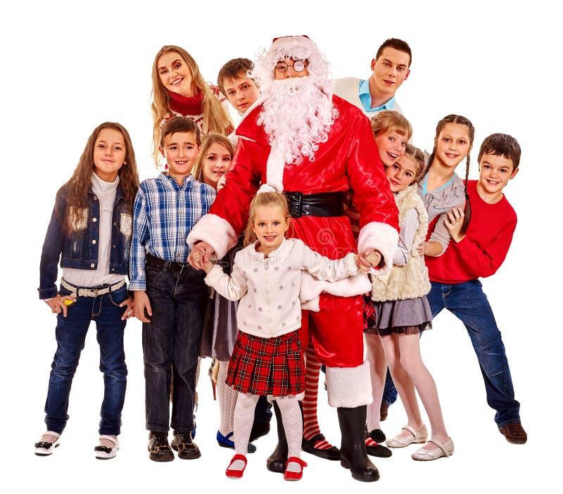 Santa Claus con un grupo de niños imagenes de archivo