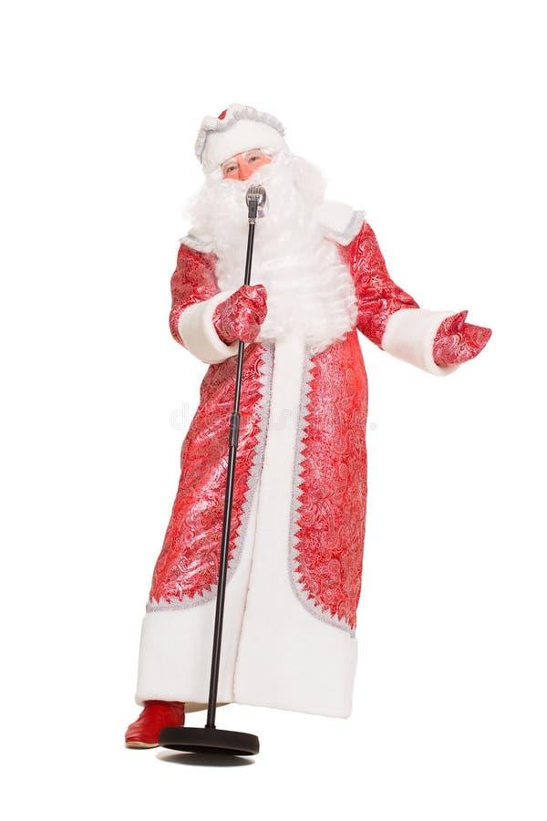 Santa Claus con un microfono immagine stock libera da diritti