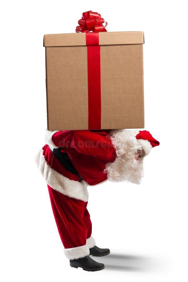 Santa Claus con un regalo grande fotografía de archivo