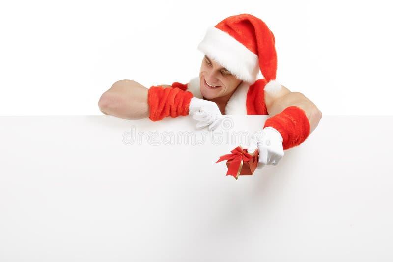 Santa Claus con ventas de una bandera imagen de archivo libre de regalías