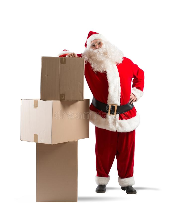 Santa Claus courier. Tired Santa Claus courier with some pack stock photo