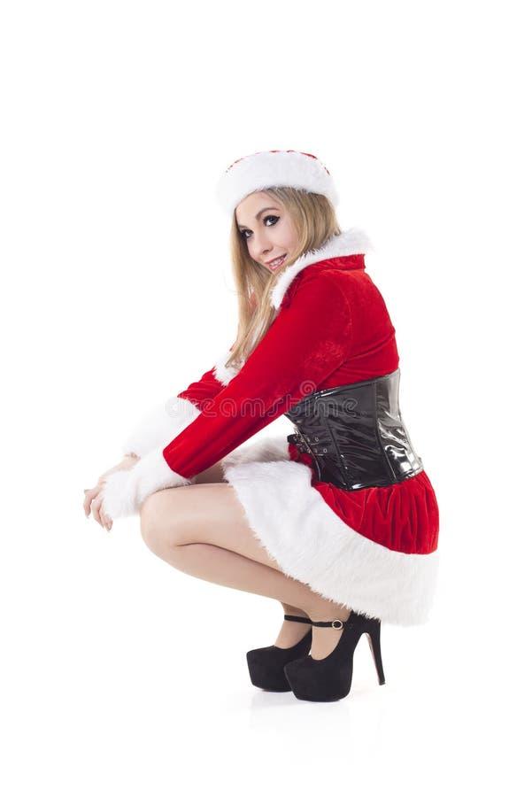 Santa Claus Crouching fêmea imagem de stock royalty free