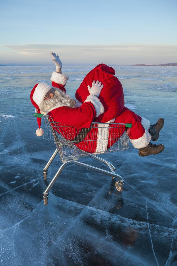 Santa Claus dans le camion avec un sac des cadeaux image stock