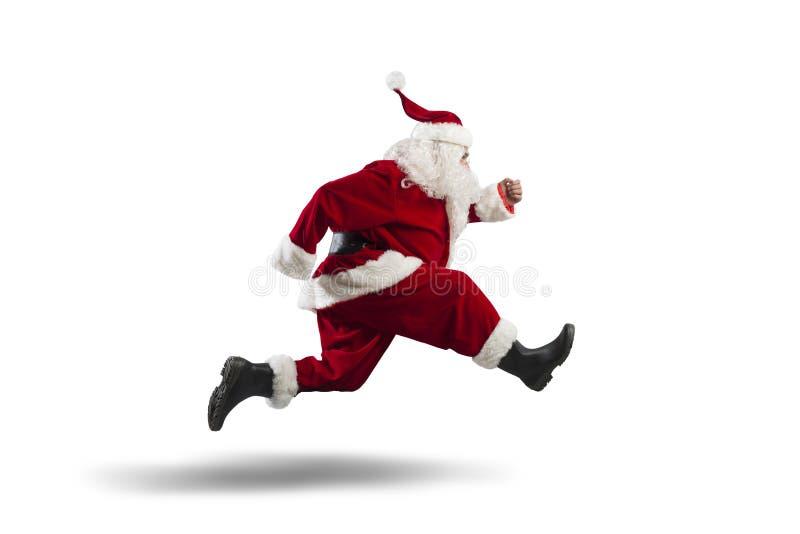 Santa Claus de funcionamiento foto de archivo libre de regalías