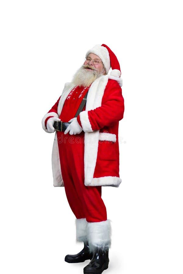 Santa Claus de sorriso que guarda sua correia imagem de stock royalty free