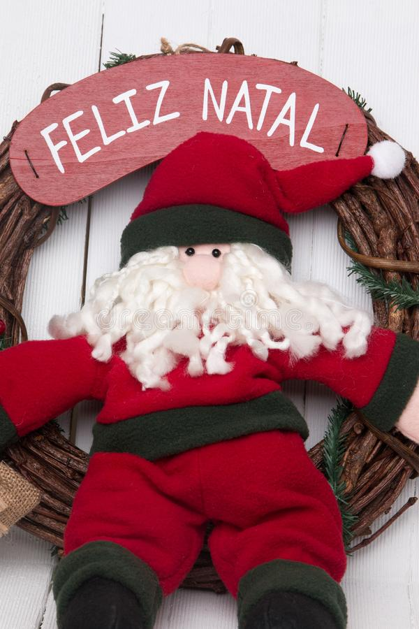 Santa claus doll. Santa claus decorative doll on a twig wreath to hand on the door royalty free stock photos