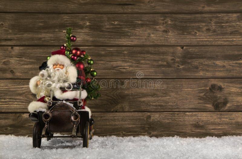 Santa Claus: Decorazione d'annata di natale su backgr marrone di legno fotografia stock