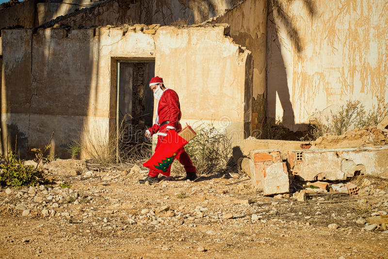 Santa Claus in depression. A fed up Santa trudging along with his sack royalty free stock photos