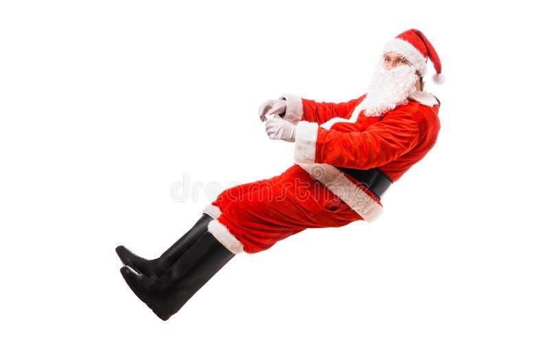 Santa Claus, die eingebildetes Auto fährt lizenzfreies stockfoto