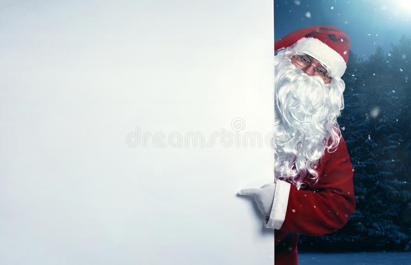 Santa Claus die op de banner richten royalty-vrije stock fotografie