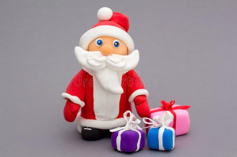 Santa Claus die van met de hand gemaakte klei wordt gemaakt stock fotografie