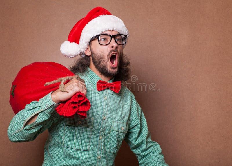 Santa Claus divertente con la borsa del regalo fotografia stock libera da diritti