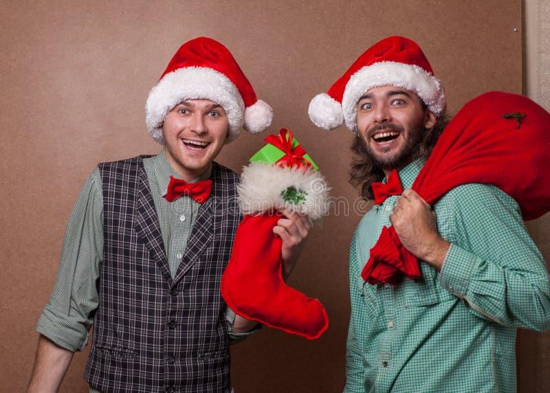 Santa Claus divertente con la borsa del regalo fotografia stock