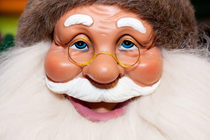 Santa Claus doll. Portrait of smiling Santa Claus doll stock images