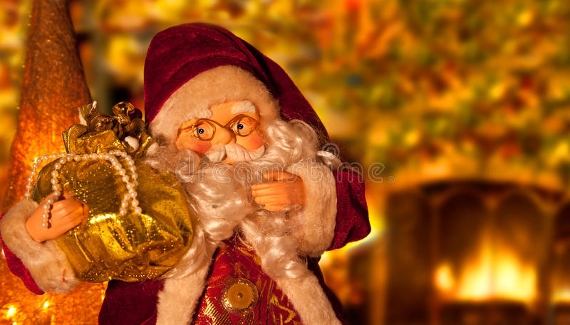Santa Claus Doll. Besides a Fireplace royalty free stock image