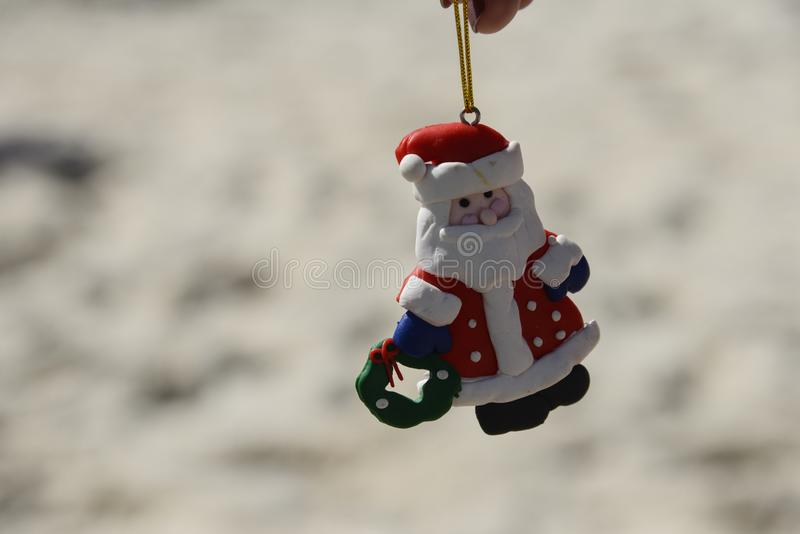 Santa Claus doll with blurred beach background. Santa Claus doll with blurred beach background stock image