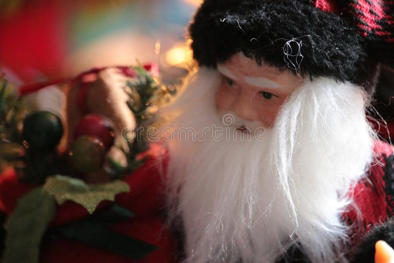 Santa Claus Doll Bokeh. Santa Clause doll by the Christmas Tree with Bokeh depth of field royalty free stock photo