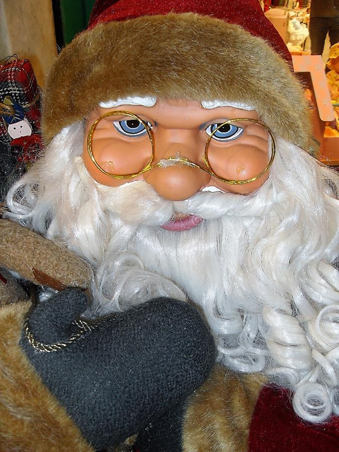 Santa Claus doll ,with glasses. stock image