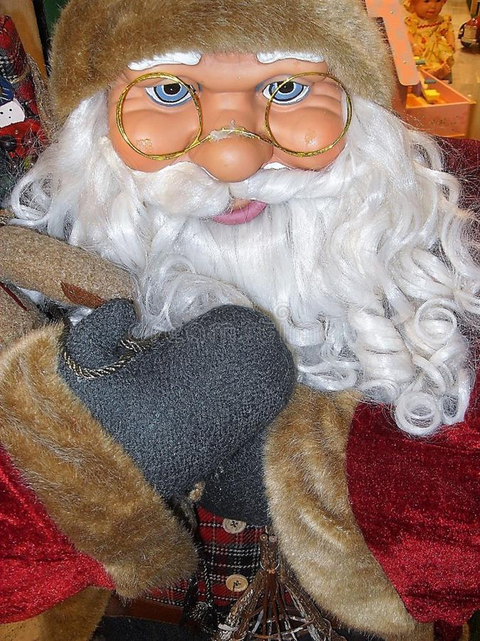 Santa Claus doll ,with glasses. stock photo