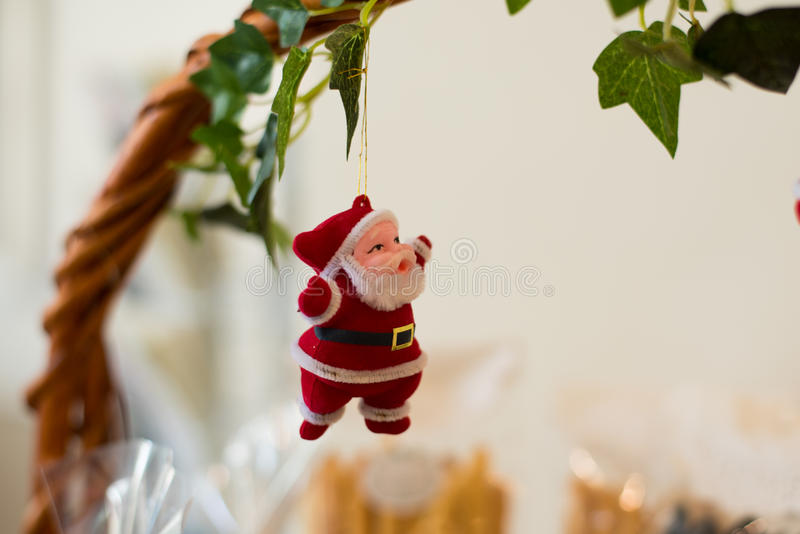 Santa claus doll. Santa claus doll hang on handle wood basket royalty free stock photography