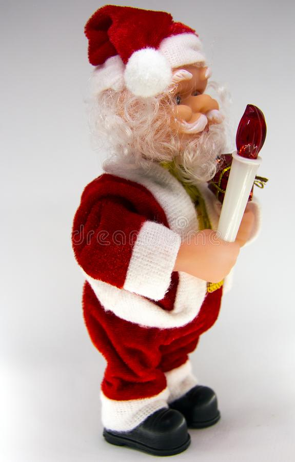 Santa Claus Doll Isolated With White Background. Adorable Santa Claus Decorative Toy, Insulator on a White Background. Christmas and New Year Symbols royalty free stock photos