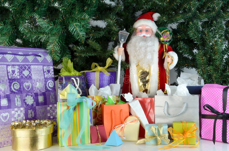 Santa Claus doll and presents stock image