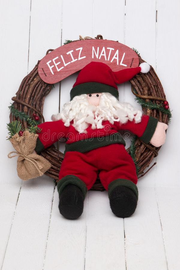 Santa claus doll. Santa claus decorative doll on a twig wreath to hand on the door royalty free stock photo