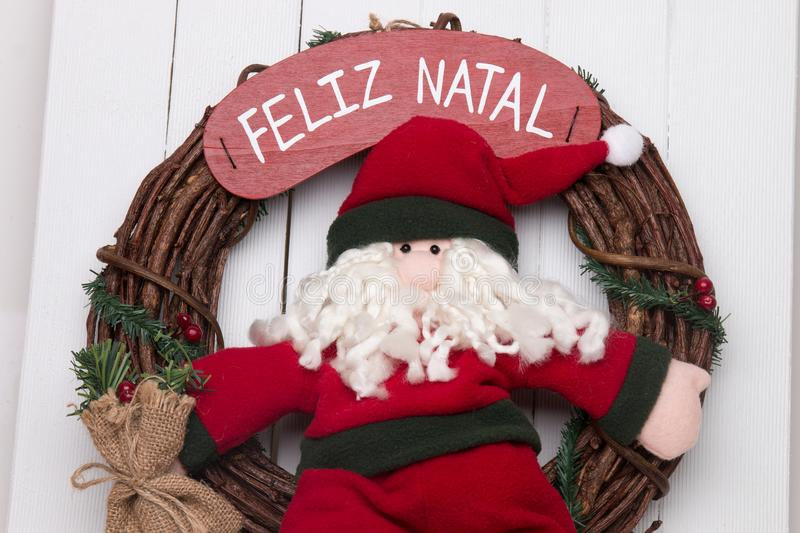 Santa claus doll. Santa claus decorative doll on a twig wreath to hand on the door stock photo