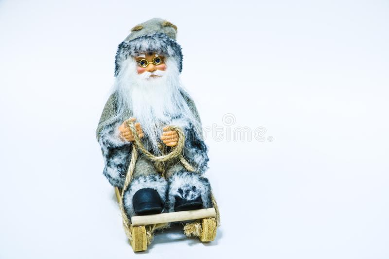 Santa Claus doll toy isolated on white background. Cute toy Santa Claus on white background. Santa claus doll.  royalty free stock photography