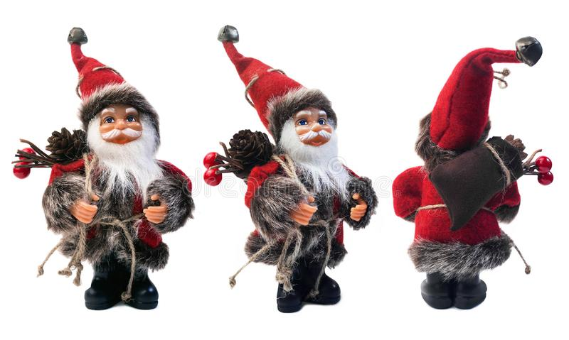 Santa Claus doll, 3 views. Santa Claus doll photo. Cute isolated Santa Claus toy with bag of presents - front, angle and back view royalty free stock image