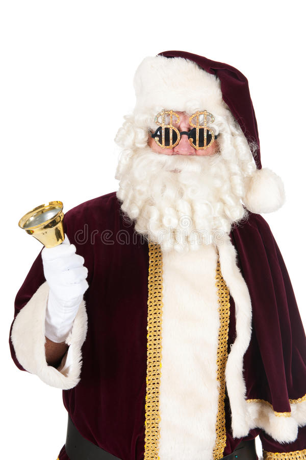 Santa Claus with dollar glasses. And copper bell for expensive Christmas stock photo