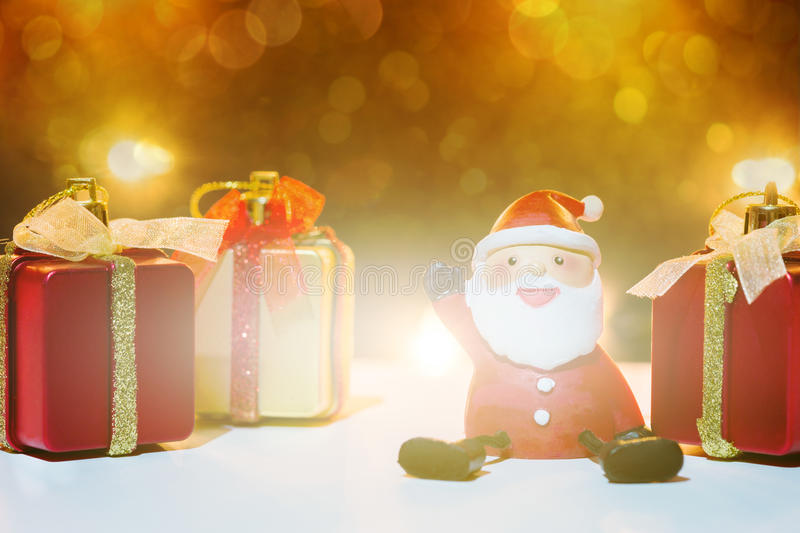 Santa Claus dolls and Christmas decorations twinkling royalty free stock photography