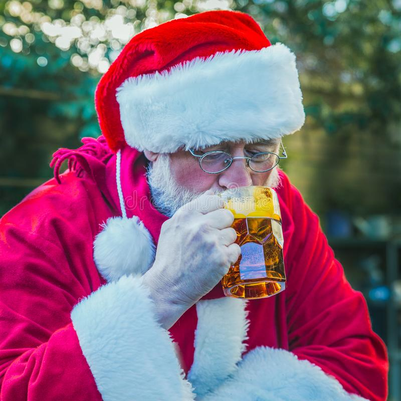 Portrait of Santa Claus with beer royalty free stock photo