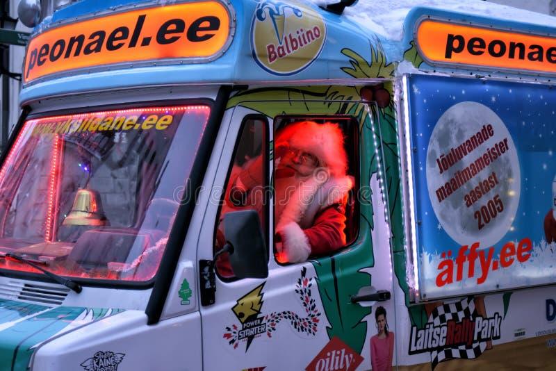 Santa Claus driving a van royalty free stock photo