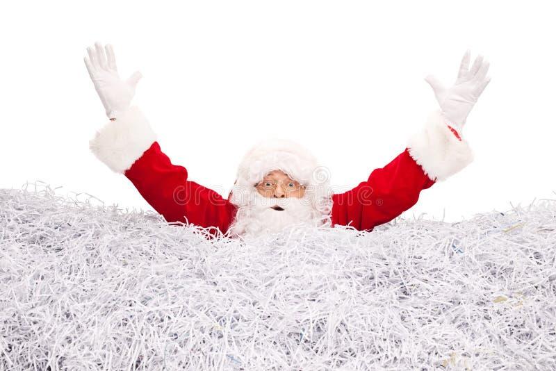 Santa Claus drunkning i strimlat papper royaltyfria foton