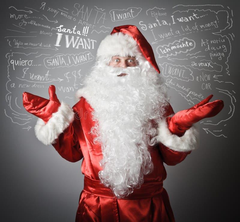 Santa Claus e muitos desejos fotografia de stock royalty free