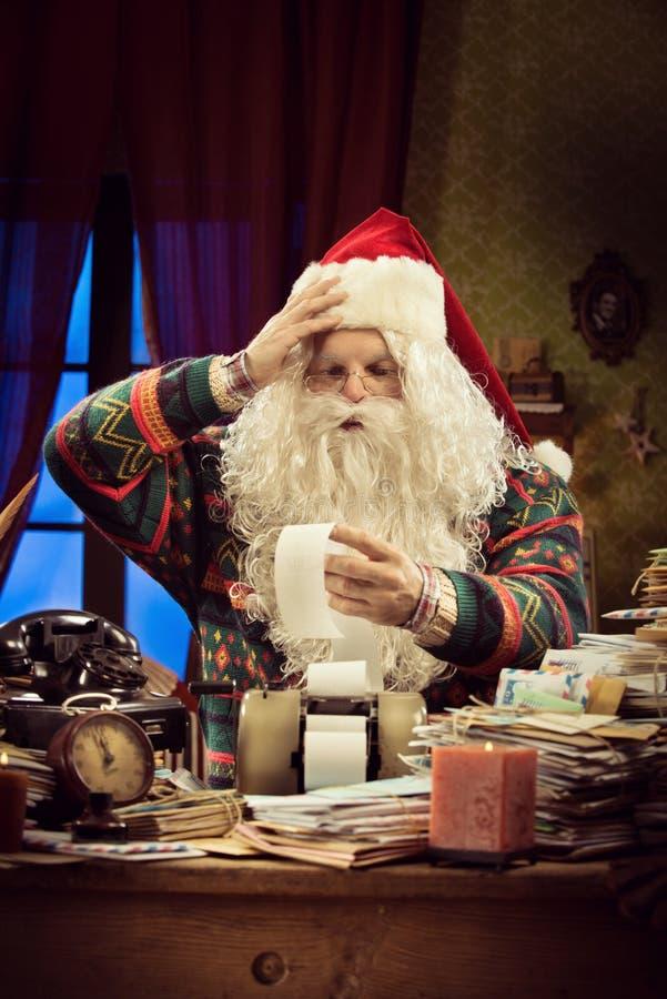 Santa Claus e problemas do imposto fotos de stock