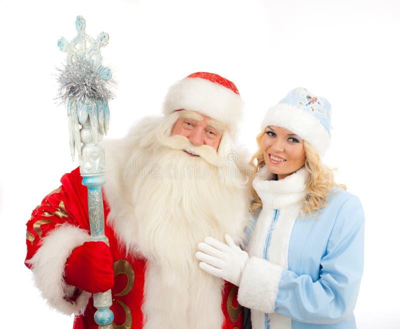 Santa Claus e ragazza della neve immagini stock libere da diritti