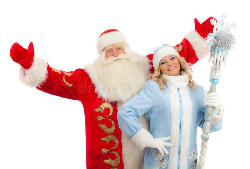 Santa Claus e ragazza della neve immagini stock