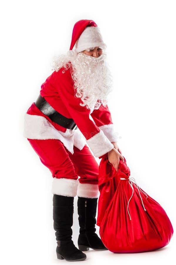 Santa Claus e um saco pesado imagem de stock royalty free