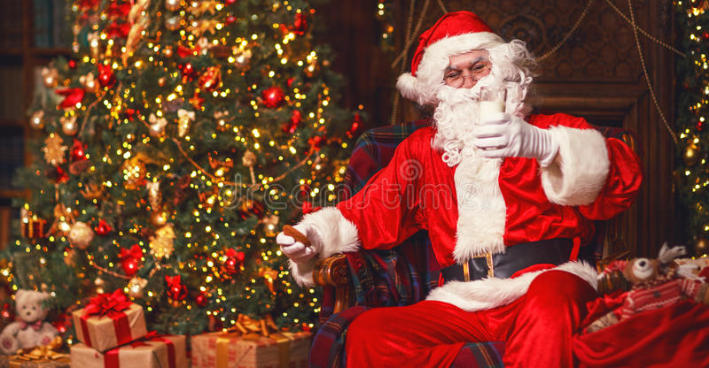 Santa Claus Eating Cookies And Drinking Milk On Christmas